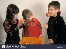 apple halloween costume children in halloween costumes apple bobbing stock photo royalty