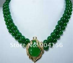 jade with gold necklace images Pale green heart shaped pendant of green jade white pearl necklace jpg