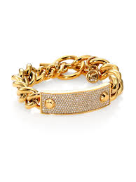 gold tone chain link bracelet images Lyst michael kors heritage plaque pav toggle bracelet goldtone jpeg
