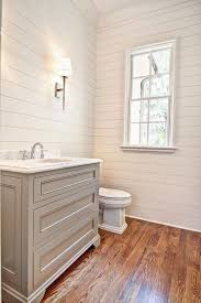 cottage powder room with complex marble inset cabinets in