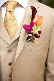 Gold Boutonniere Gold Suite And Tie Plus An Autumn Themed Floral Wedding