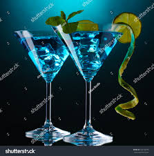 martini blue blue cocktail martini glasses on blue stock photo 104720795