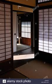 the interior of a traditional japanese house with screen doors and