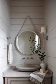 how to decorate with mirrors studio mcgee use bathroom mirrors as an opportunity to do something unexpected we re so used to the standard shape size and materials that sometimes it s fun to mix