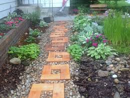 backyard garden wood and stone path with cedar stepping stones