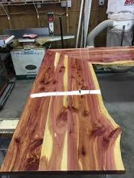 shaped kitchen island made of cedar tree designs pinterest eastern red cedar live edge kitchen island with reclaimed cabinets