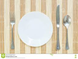 Kitchen Table Close Up Closeup White Ceramic Dish With Stainless Fork And Spoon And Knife