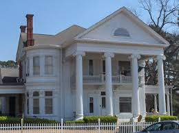 greek revival style house greek revival style architecture house with pillars holding an