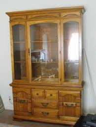solid oak china cabinet solid oak china cabinet as new 4 beveled glass doors into top half