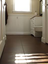 dark brown tile in bathroom floor white subway tile in tub
