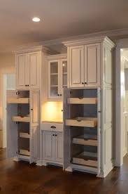 Pantry Cabinet With Pull Out Shelves by Hidden Pantry With Stacked Pull Out Shelves Transitional