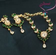 gold green necklace images Gold plated american diamond green marquee stones necklace earrings jpg