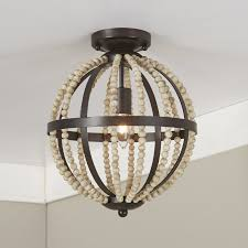 wood bead ceiling light row after row of natural wooden beads orbit around this flesh
