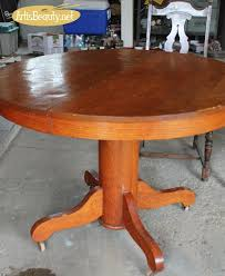 art is beauty antique round pedestal table and mismatched chair