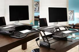 a stand up desk converter in dining table