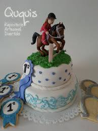 equestrian style cake with rosette horse shoes stirrups english