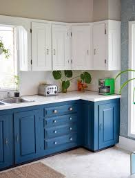 electric blue kitchen cabinets electric blue and white cabinets with knobs and handles look