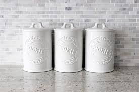 white ceramic kitchen canisters and tea coffee storage jars