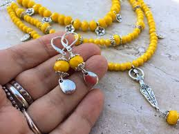 boho necklace set images Yellow multistrand fertility goddess long boho leather necklace JPG