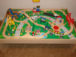 table top train set kidkraft wooden train table with 3 bins and 120 piece waterfall