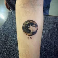 tattoos moon on the forearm