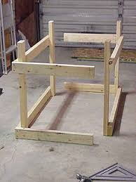 Tool Bench For Garage How To Build A Low Cost Sturdy Work Bench From 2x4 U0027s And Osb