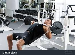 bench barbell incline bench young bodybuilder training in the