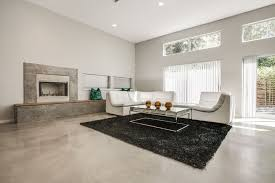 Rugs In Dallas Tx Contemporary Living Room With Concrete Floors U0026 Stone Fireplace In