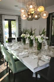 Dining Rooms With Chandeliers by This Dining Room With Its Gorgeous Chandelier And Marble Table
