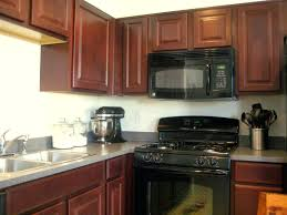 kitchen cabinets distressed kitchen cabinets black granite countertops white with images dark