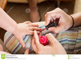 painting little girls nails stock photo image 68265140