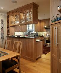 Range Hood Cathedral Ceiling by Cherry Cabinets Backsplash With Track Lighting Kitchen