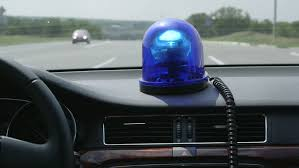 blue light on car driving car with blue flashing light on highway stock footage video