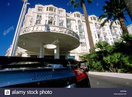 luxury car parked in front of the prestigious martinez hotel in