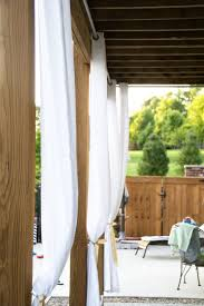 How To Make Curtains Hang Straight Hanging Outdoor Curtains The Polkadot Chair