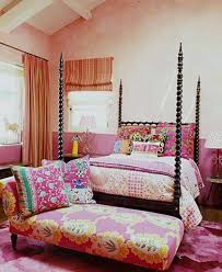 bohemian style master bedroom with chesnut bed framed and colorful