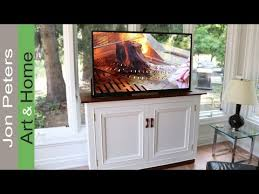 auto raising tv cabinet how to build a tv lift cabinet youtube