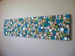 the colours painted wood slice collage wall artsy