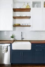 wood countertops dark blue kitchen cabinets lighting flooring sink