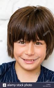 caucasian boy 11 year child and shoulders facing