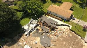two homes florida sinkhole that swallowed two homes gets even bigger daily