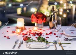 pool side candlelight dinner romantic sunset stock photo 564796591