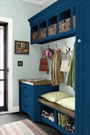 navy mudroom locker with a storage bench living space