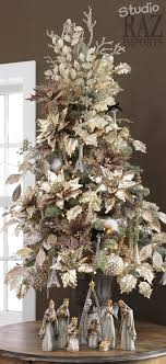 white tree decorated with light gold silk poinsettias