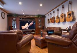 interior excellent small home theater with guitar decor and