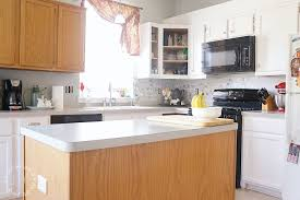 how to add trim to bottom of kitchen cabinets how to customize a kitchen island with trim lost found