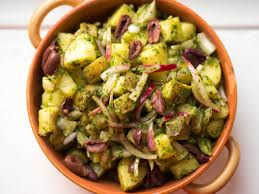 yukon gold potato salad with tarragon pesto and pickled onions