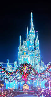 best 25 disney castle wallpaper ideas on pinterest castillo de christmas disney magic kingdom castle with the wreaths photographer unknown have a wonderful christmas