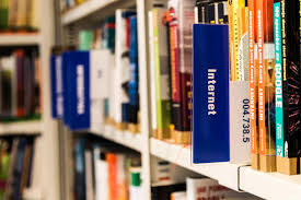 books on shelf in library free stock photo