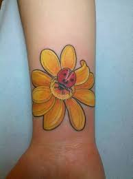 yellow rose flower with ladybug tattoo on waist tattooshunter com